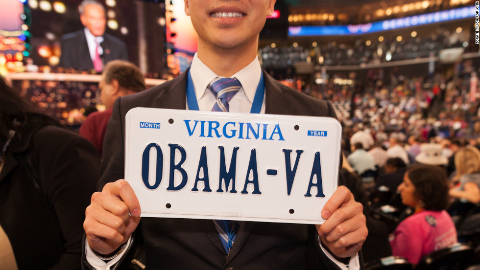 A man shows off an authentic Virginia Obama car plate on Wednesday.