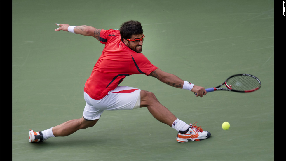Tipsarevic makes a backhand return to Ferrer.
