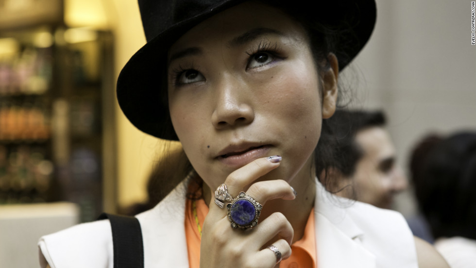 Yuriko Ogura, 22, takes a moment to browse.
