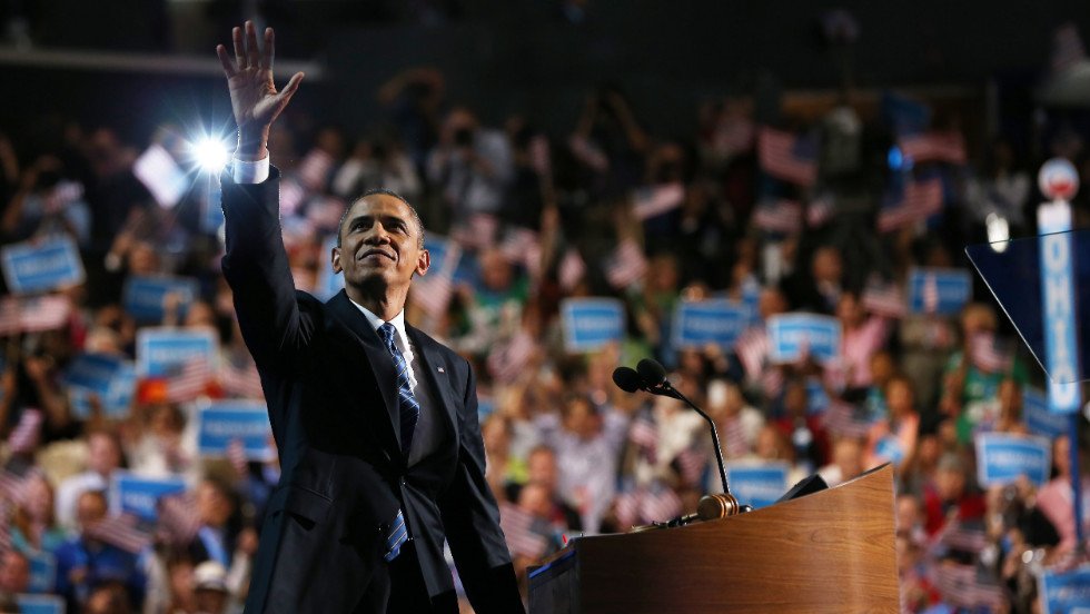 Barack Obama waves from the stage on Thursday.