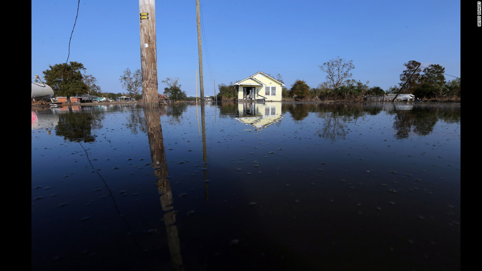 Floodwaters linger Thursday in Braithwaite, Louisiana.