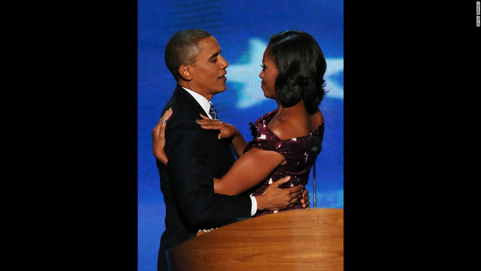 Barack Obama embraces his wife, Michelle, after giving his acceptance speech on Thursday.