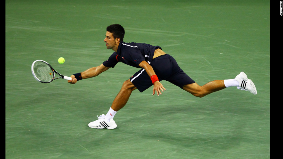 Djokovic lunges to make a return.