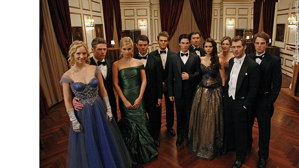 "The characters on ""The Vampire Diaries"" got all dolled up to attend a ball at vampire Klaus' (Joseph Morgan) house last season. ""We wanted it to have a Cinderella feel to it,"" costume designer Leigh Leverett said. Candice Accola's character Caroline, far left, donned an Alberto Makali dress, while Nina Dobrev's Elena, fourth from the right, wore a vintage black and gold ball gown. As for vampire Rebekah, played by Claire Holt, third from the left, ""This was the first dress she tried on. ... Rebekah has been around for 1,000 years ... her look is a little more sophisticated than our Mystic Falls girls."""