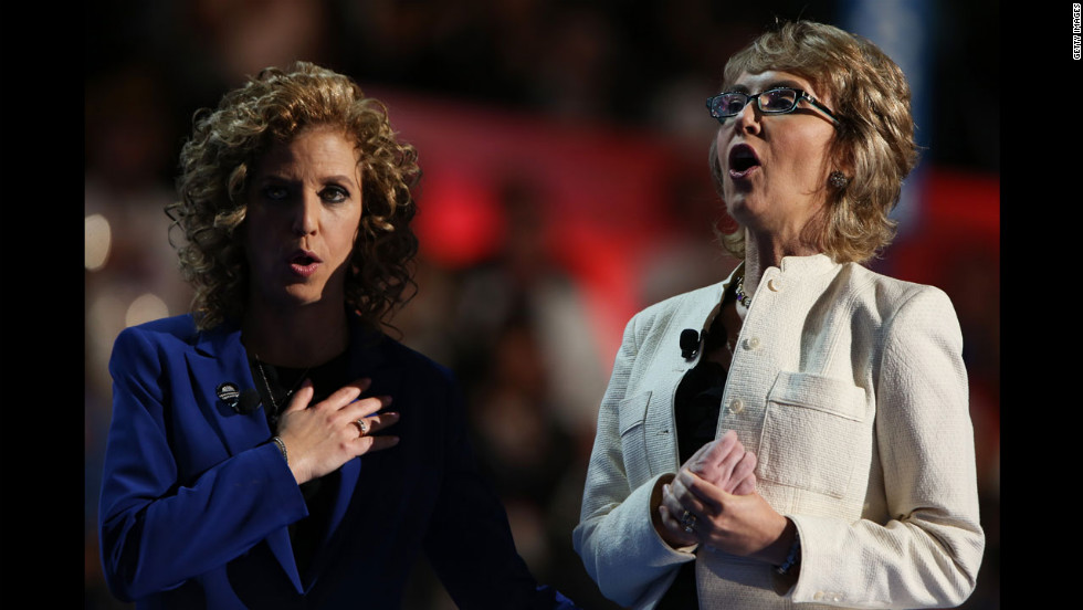 Former U.S. Rep. Gabrielle Giffords, right, recites the Pledge of Allegiance on stage with Democratic National Committee Chair Debbie Wasserman Schultz on Thursday.