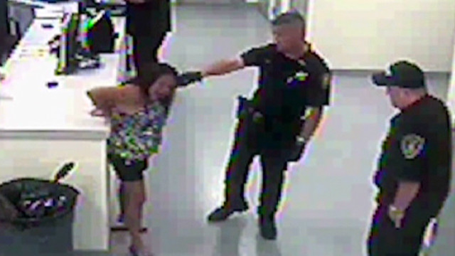 evexp cop tases woman in handcuffes_00000703