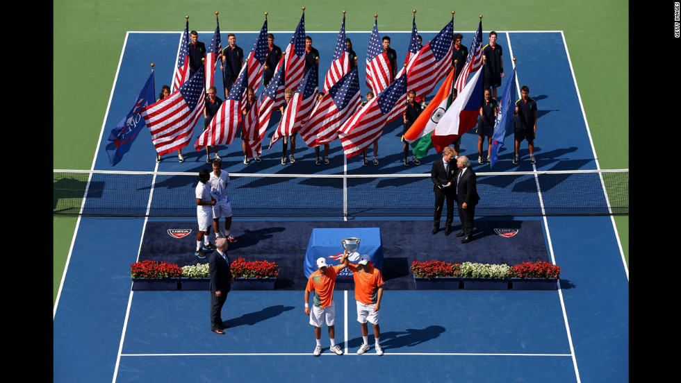 Bob Bryan and Mike Bryan of the United States pose with their trophy after their men's doubles final match against Leander Paes of India and Radek Stepanek of the Czech Republic on Friday.