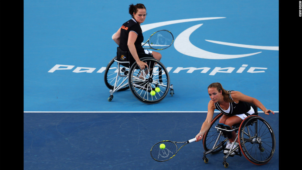 Aniek Van Koot, left, and Jiske Griffioen of the Netherlands in action against Marjolein Buis and Esther Vergeer, also of the of Netherlands, in the women's doubles gold medal match.