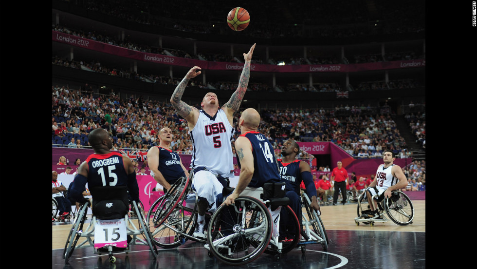 The United States' Joseph Chambers reaches for the ball during Saturday's bronze medal wheelchair basketball game between United States and Great Britain.