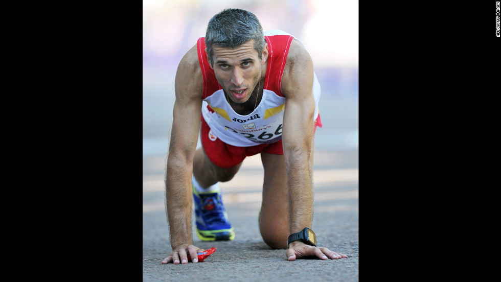Spain's Alberto Suarez Laso reacts after finishing in first place in the men's marathon T12 in central London on Sunday.