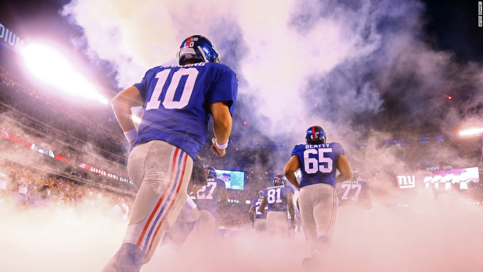New York Giants quarterback Eli Manning, No.10, takes the field at MetLife Stadium in East Rutherford, New Jersey, for the season opener against the Dallas Cowboys on Wednesday, September 5.