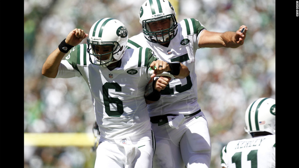 No. 6 Mark Sanchez and No. 15 Tim Tebow of the Jets celebrate a touchdown against the Bills during their season opener at MetLife Stadium in Rutherford, New Jersey, on Sunday.