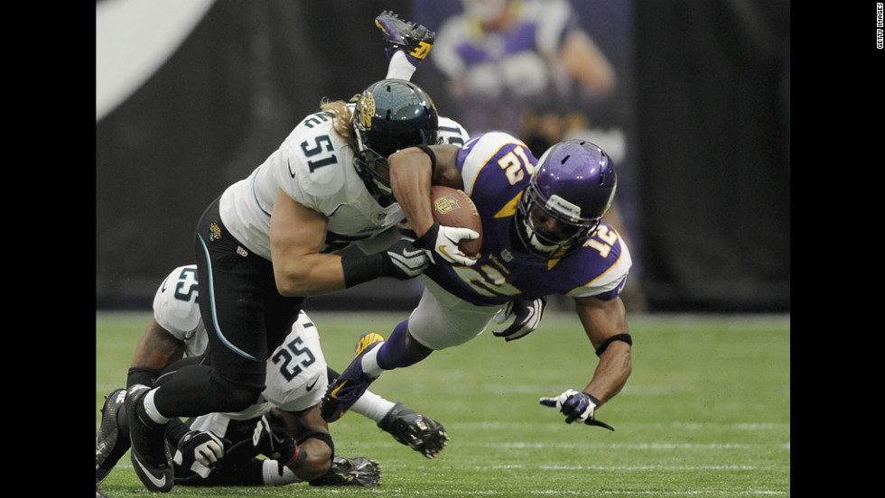 No. 51 Paul Posluszny of the Jaguars brings down No. 12 Percy Harvin of the Vikings during the first quarter of the season opener in Minneapolis on Sunday.
