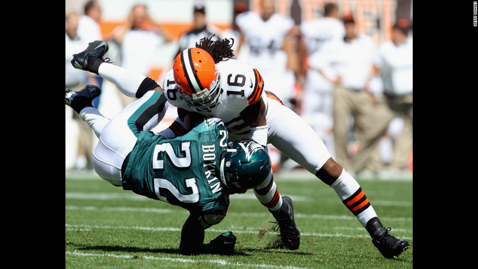 Cornerback No. 22 Brandon Boykin of the Eagles is hit by wide receiver No.16 Joshua Cribbs of the Browns on Sunday in Cleveland.