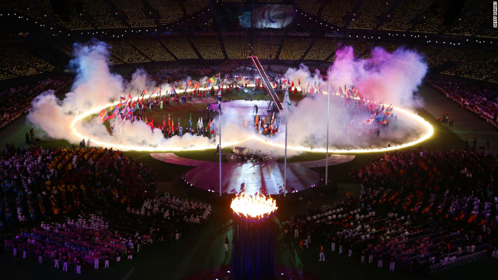 A heart of flames is displayed on the arena floor.