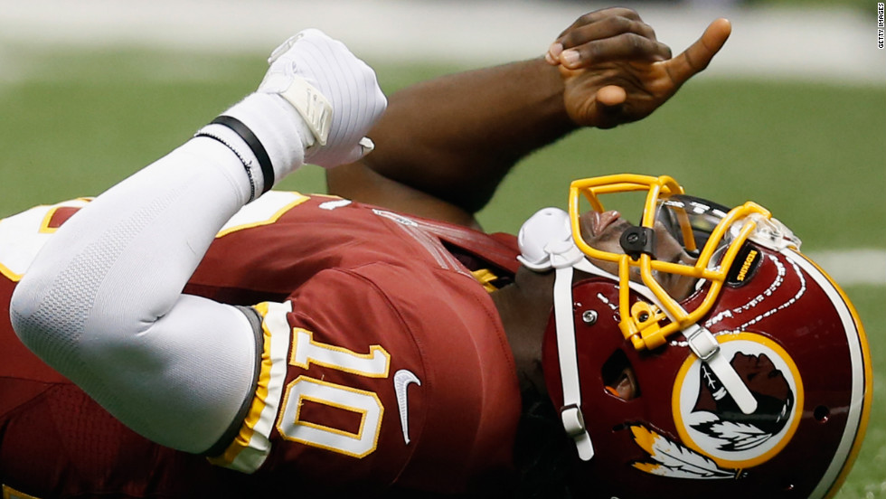 No. 10 Robert Griffin of the Redskins celebrates after throwing a touchdown pass against the Saints on Sunday.