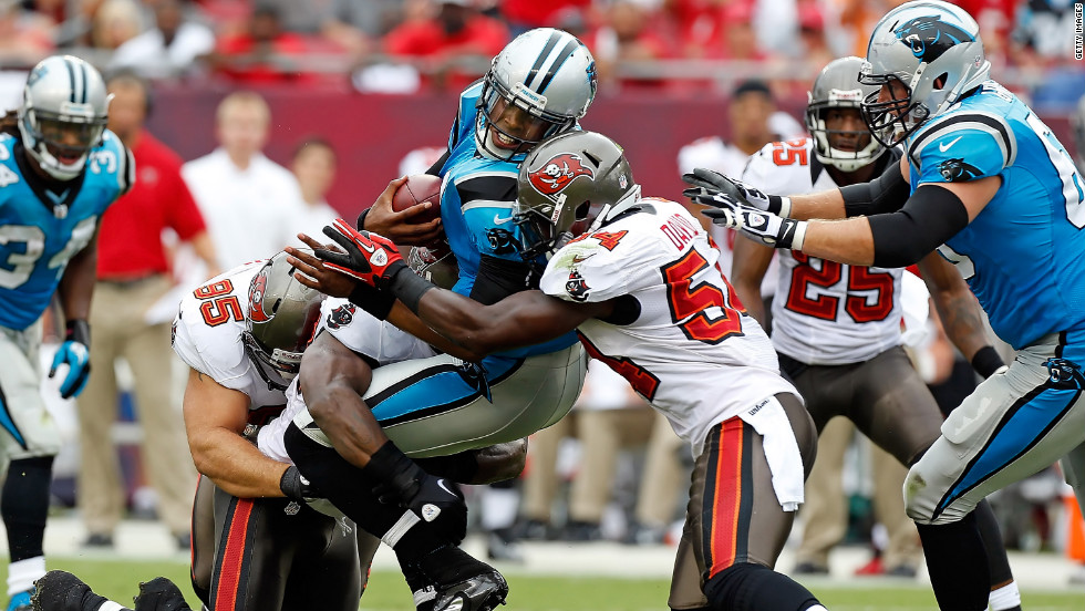 No. 54 linebacker Lavonte David of the Buccaneers tackles No.1 quarterback Cam Newton of the Panthers on Sunday.