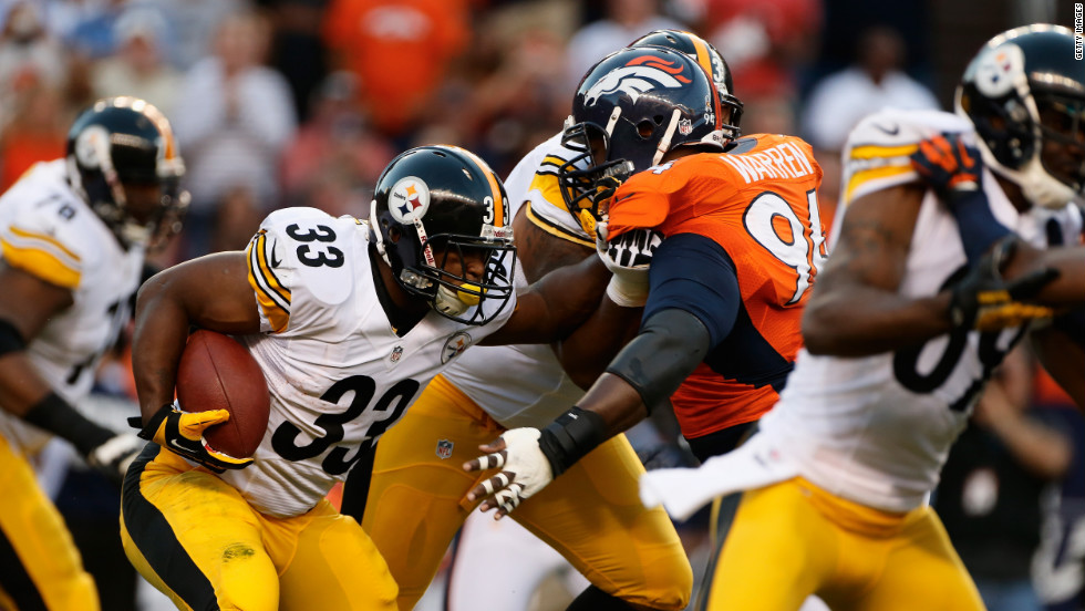 No. 33 running back Isaac Redman of the Pittsburgh Steelers holds off No. 94 linebacker Lawrence Timmons of the Denver Broncos on Sunday.