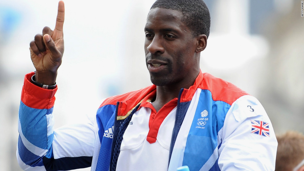 Track sprinter Dwain Chambers salutes the crowd. Chambers almost missed out on participating in the Olympics after failing a drugs test in 2003. His life ban was overturned in April, 2012.