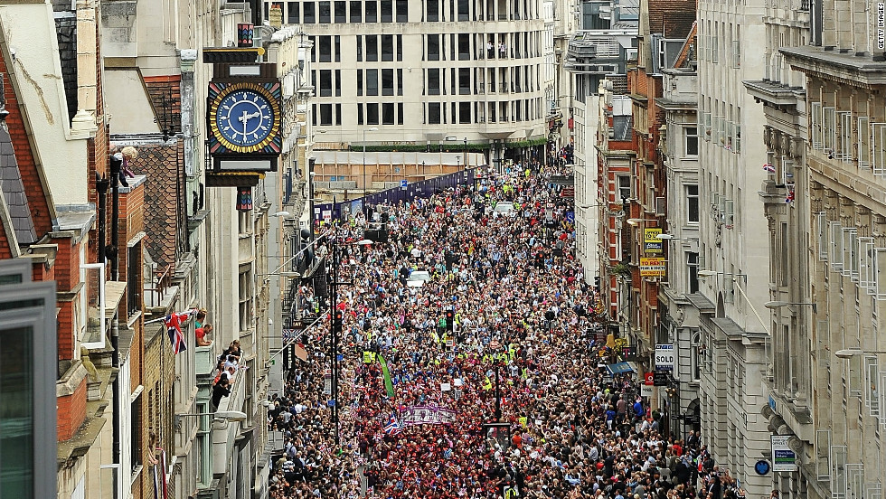 The Victory Parade passes through the crowds lining Fleet Street, London.