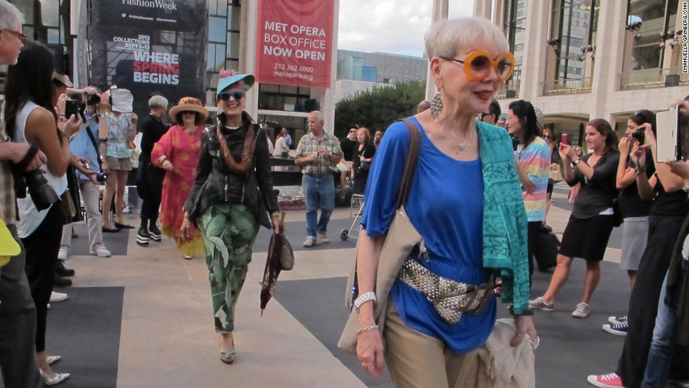 Crowds gathered around the women to take pictures as they sauntered down a makeshift runway in the plaza. Inside the venue, Fashion Week attendees lined up for Diane Von Furstenberg's runway show.