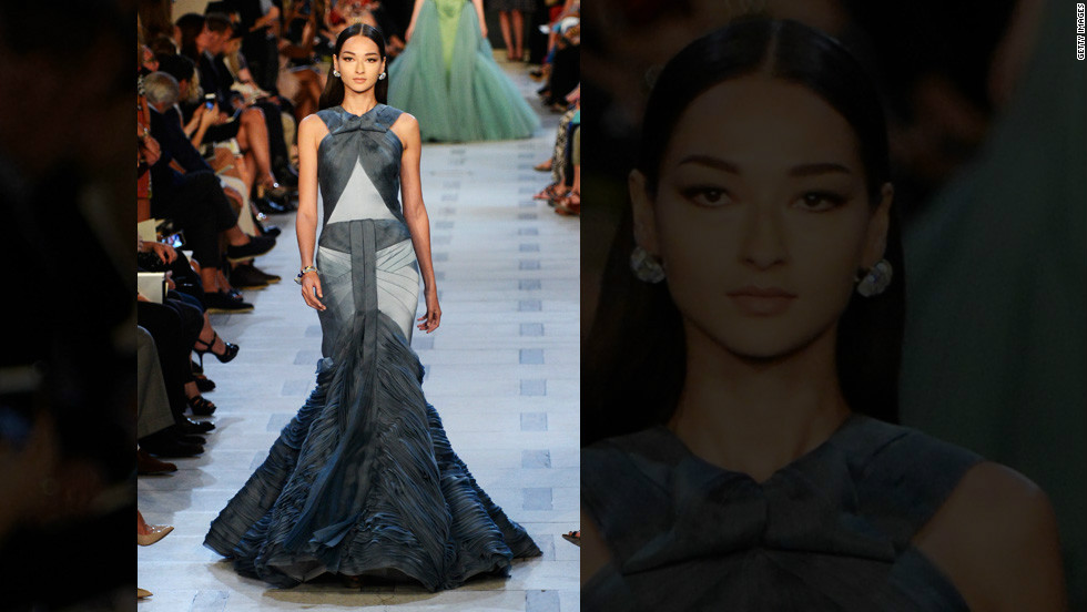 Zac Posen, known for designs that evoke glamour, dresses models in show-stopping gowns at his spring runway show.