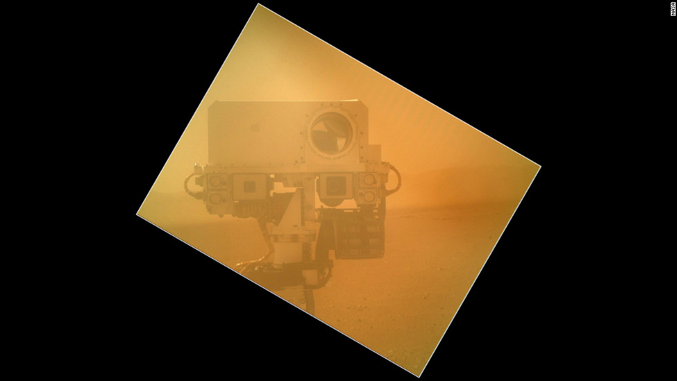 The Curiosity rover used a camera on its arm to obtain this self-portrait on September 7, 2012. The image of the top of Curiosity's Remote Sensing Mast, showing the Mastcam and Chemcam cameras, was taken by the Mars Hand Lens Imager. The angle of the frame reflects the position of the MAHLI camera on the arm when the image was taken.