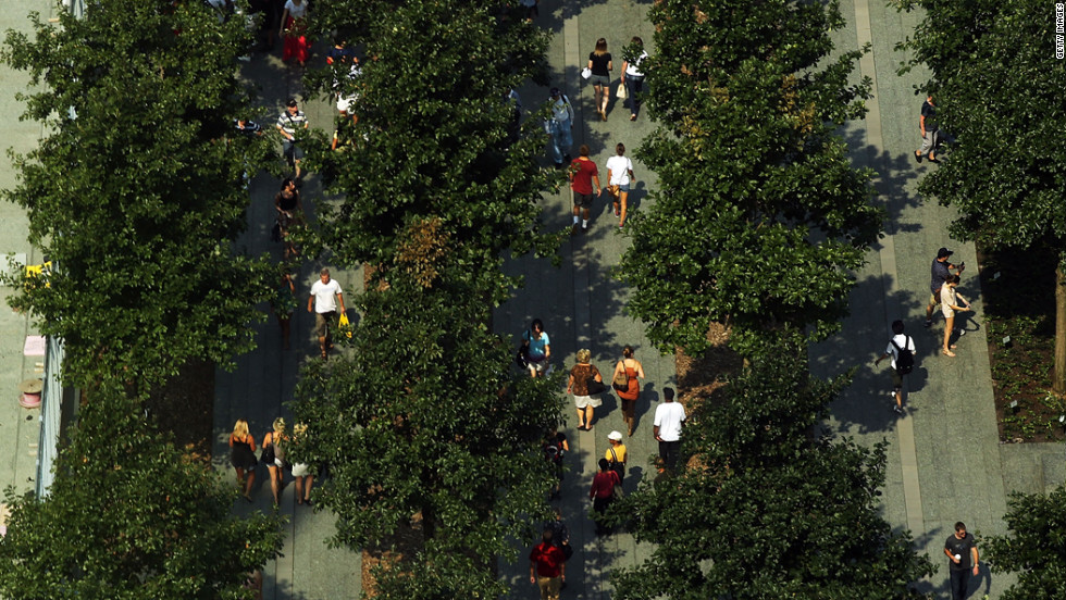 Visitors walk through the grounds of the National September 11 Memorial & Museum on Friday.