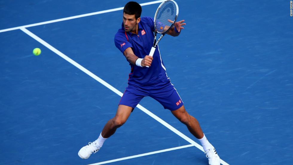 Novak Djokovic of Serbia returns a shot at the 2012 U.S. Open on Monday.