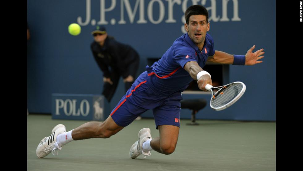 Novak Djokovic returns a shot against Andy Murray on Monday.