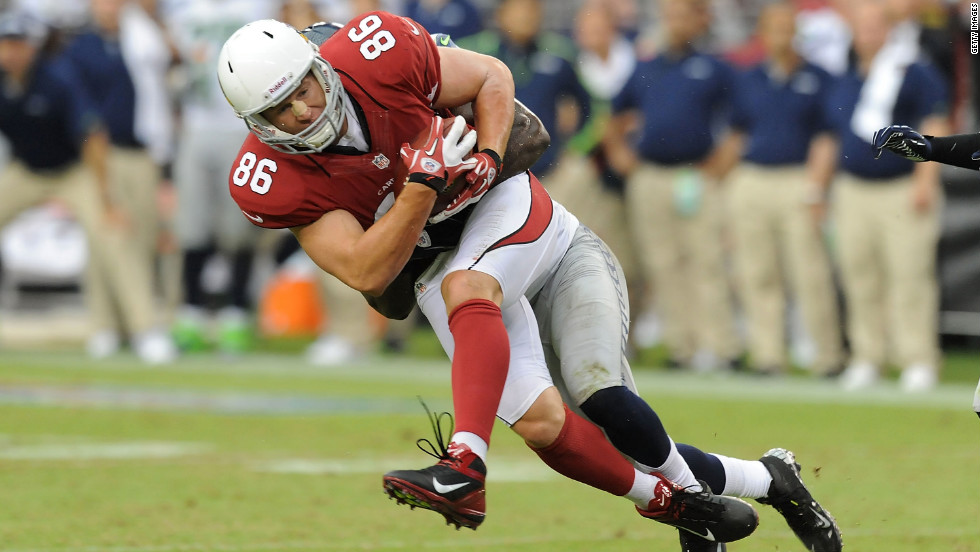 No. 86 Todd Heap of the Cardinals is tackled after making a catch against the Seahawks on Sunday.