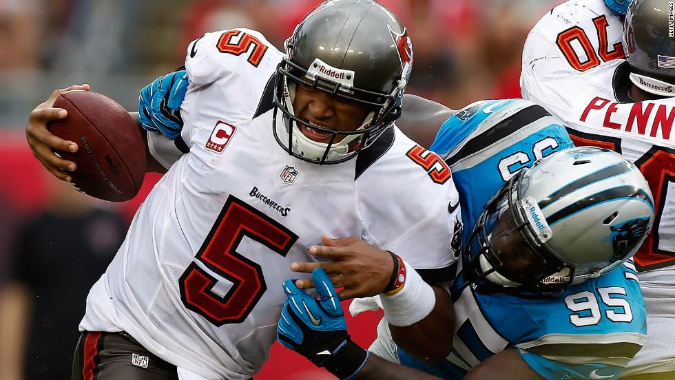No. 95 defensive end Charles Johnson of the Carolina Panthers sacks No. 5 quarterback Josh Freeman of the Tampa Bay Buccaneers on Sunday.
