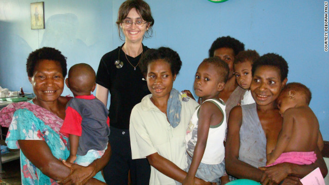 Dr. Deborah Mills works abroad in a vaccination clinic.