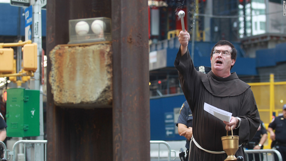 Jordan blesses the cross before it is lowered into the museum at the World Trade Center site on July 23.