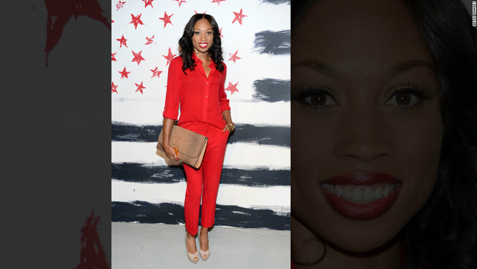 Allyson Felix, who won gold at the 2012 Olympics in the 200-meter sprint and the 4x100 and 4x400 relays, poses in front of stars and stripes at the Alice + Olivia by Stacey Bendet presentation.