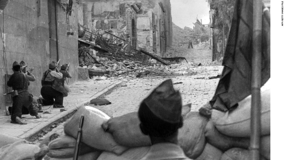 The Spanish Civil War breaks out on July 17, 1936. Pictured are Republicans battling for the Alcazar in Toledo where rebels, ultimately saved by troops under Francisco Franco, were sheltered.