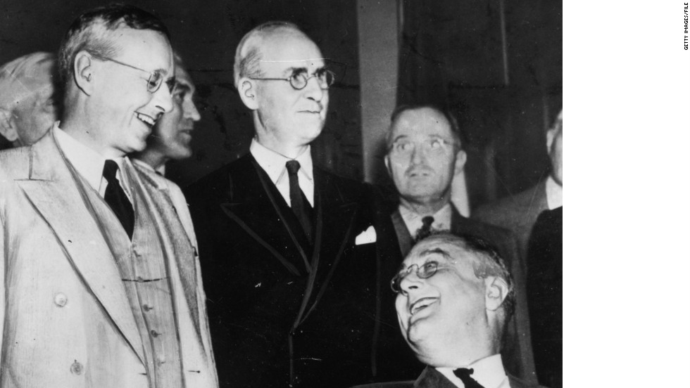 U.S. President Franklin Delano Roosevelt, seated at right, is re-elected on November 3, 1936, in a landslide victory over Kansas Governor Alfred Landon, pictured greeting him.