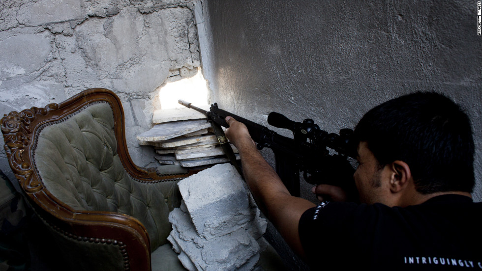 A Syrian rebel sniper shoots at forces loyal to Syrian President Bashar al-Assad in the Seif al-Dawla area in the embattled northern Syrian city of Aleppo on Monday, September 10.