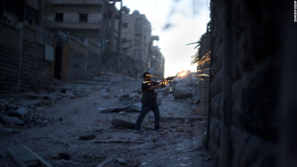A Free Syria Army fighter fires his weapon during heavy clashes with government forces in the Izza neighbourhood of Aleppo on Sunday.
