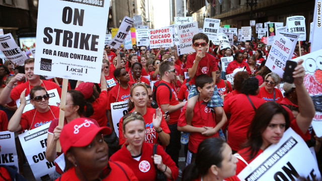 Chicago public school teachers march through the Loop and in front of the Chicago Public Schools building on September 10.