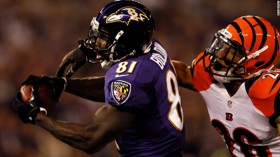Wide receiver Anquan Boldin of the Baltimore Ravens catches a 34-yard touchdown pass against defensive back Taylor Mays of the Cincinnati Bengals on Monday.