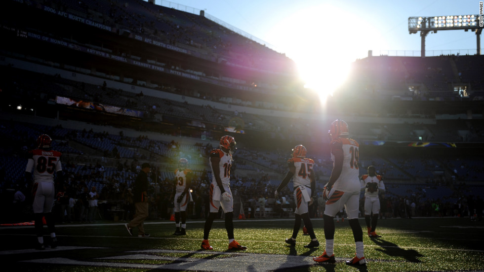 Cincinnati Bengals players warm up on the field before taking on the Baltimore Ravens at M&T Bank Stadium on Monday in Baltimore, Maryland.