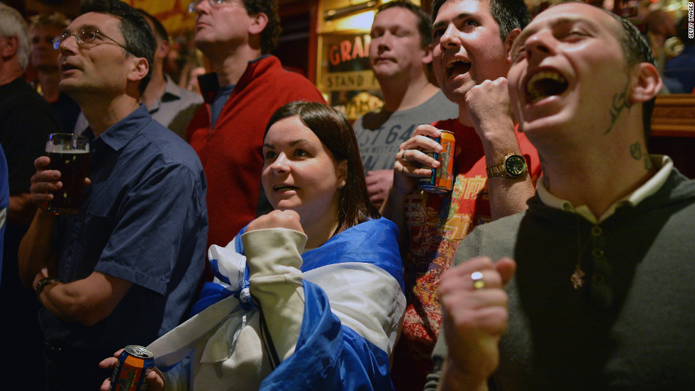 Fans of tennis player Andy Murray react as they watch his U.S. Open men's singles final match against Novak Djokovic in the bar of The Dunblane Hotel on Monday in his hometown of Dunblane, Scotland.