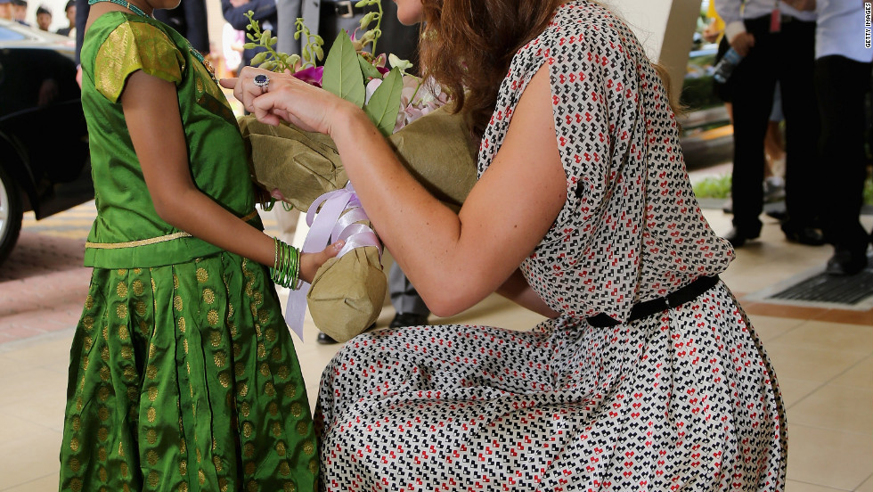 A young girl gives flowers to Catherine on Wednesday.