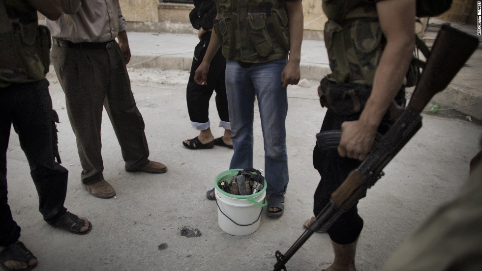 Syrian rebels gather around a bucket of mortars while fighting with scarce ammunition in the Saif al-Dawla neighborhood of Aleppo on Wednesday.