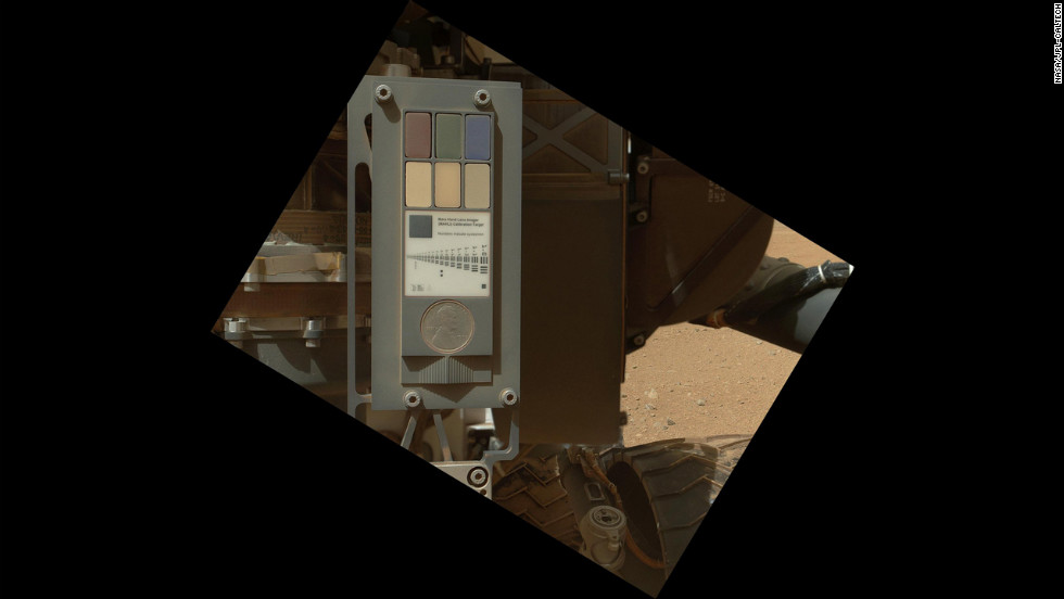 This is the calibration target for the imager. This image, taken on September 9, 2012, shows that the surface of the calibration target is covered with a layor of dust as a result of the landing. The calibration target includes color references, a metric bar graphic, a penny for scale comparison, and a stair-step pattern for depth calibration.