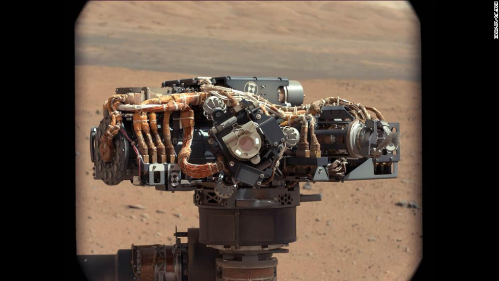 Researchers also used the mast camera to examine the Mars Hand Lens Imager on the rover to inspect its dust cover and check that its LED lights were functional. In this image, taken on September 7, 2012, the imager is in the center of the screen with its LED on. The main purpose of Curiosity's imager camera is to acquire close-up, high-resolution views of rocks and soil from the Martian surface.