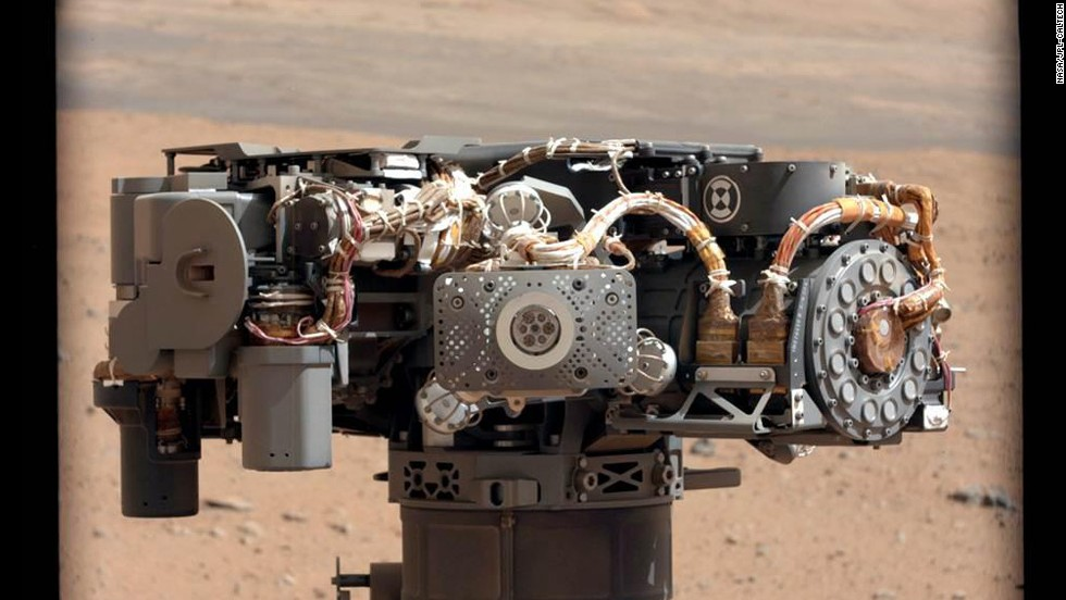 Researchers used the Curiosity rover's mast camera to take a photo of the Alpha Particle X-Ray Spectrometer. The image was used to see whether it had been caked in dust during the landing.