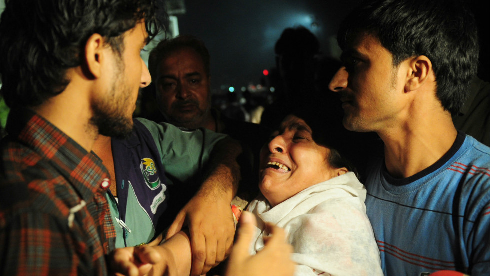 A Pakistani woman mourns the death of her relatives in the fire. Between 400 and 500 people were in the factory as it burned. Several trapped workers jumped from upper floors, said Mustafa Jamal, a senior government official in Baldia Town.