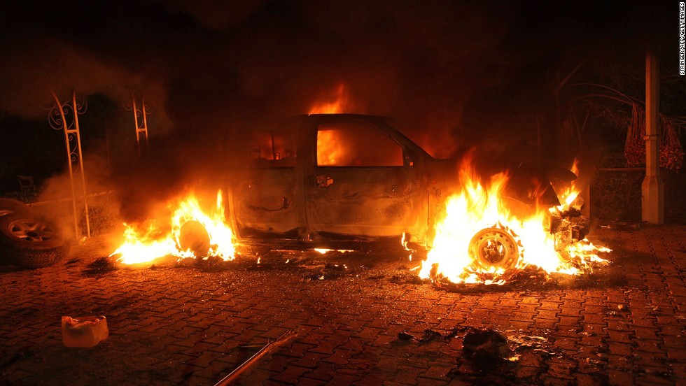 A vehicle and the surrounding area are engulfed in flames after it was set on fire inside the compound on Tuesday.